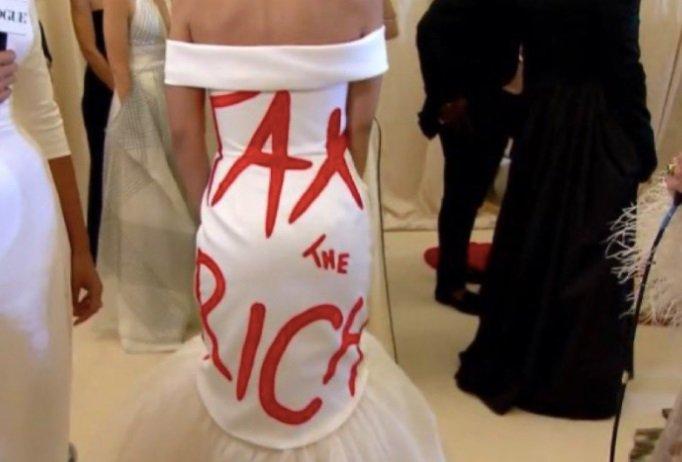 AOC Wears a High End Designer 'Tax The Rich' Dress to ...